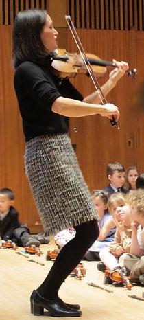 Suzuki Violin Teacher leading student concert