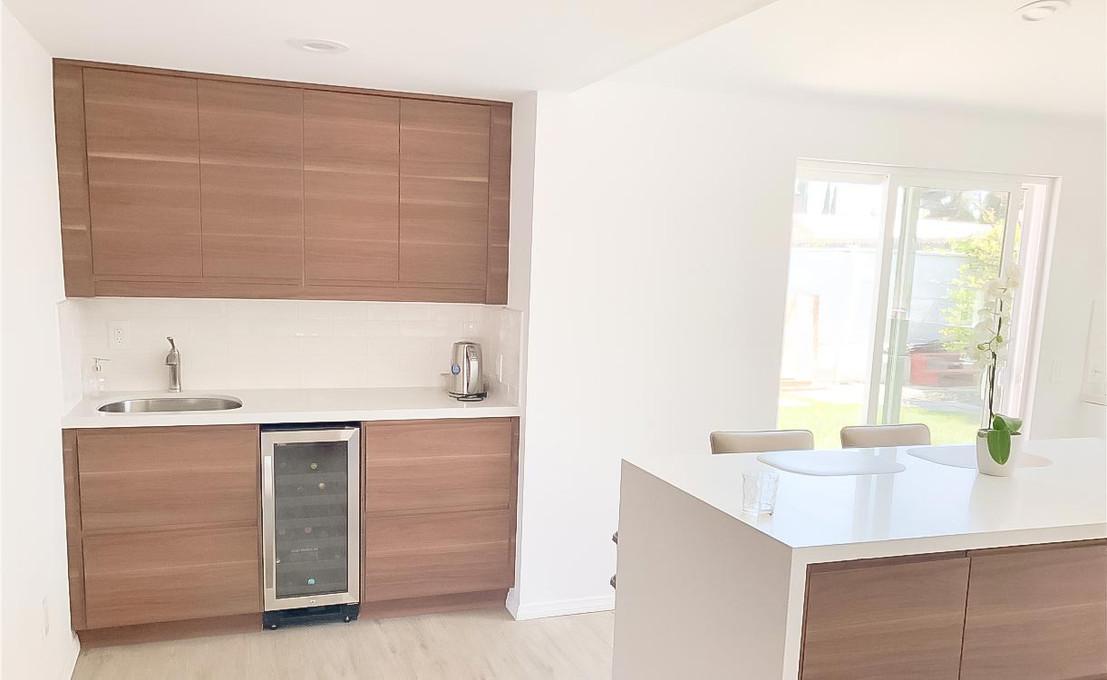 brown-kitchen-white-quartz-counter.jpg
