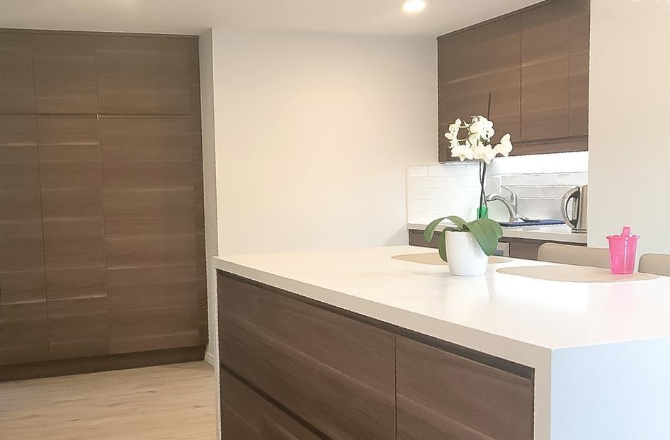 brown-kitchen-white-quartz-counter-1.jpg