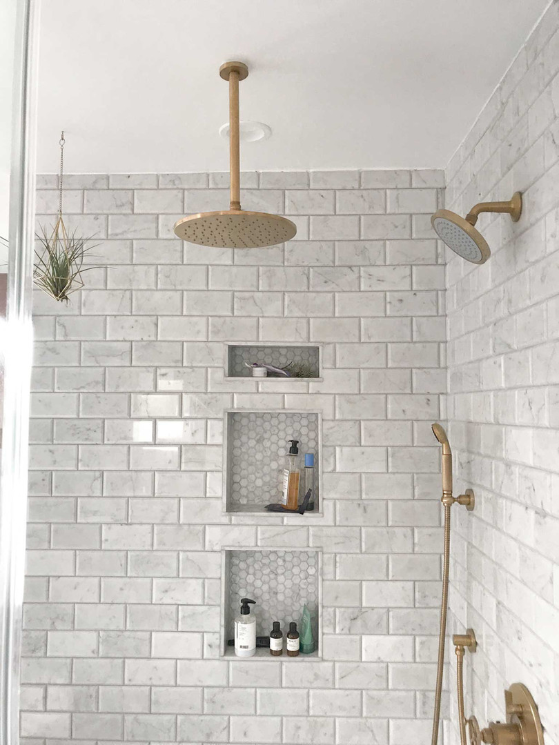 gold-fixtures-marble-subway-tile.jpg
