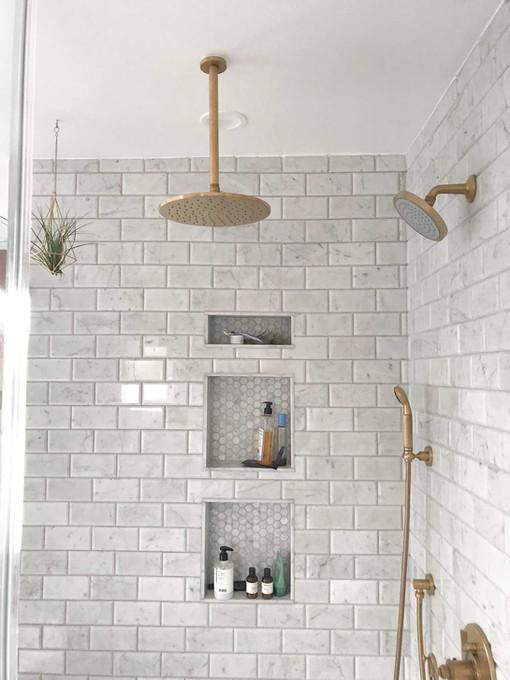 gold-fixtures-marble-subway-tile.jpg