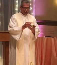 Fr Mike Holy Eucharist Pic.jpg
