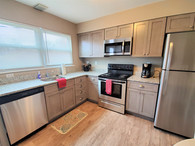 All of our student housing kitchens come complete with a refrigerator, stove, microwave, and dishwasher!