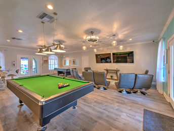 Billiard and theater room in clubehouse