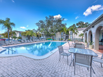 Grab a table by our lavish swimming pool!