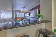Granite kitchen countertops and kitchen stools.