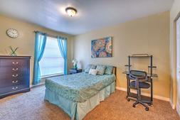 Student Bedroom w/ desk & full-sized bed.