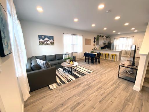 Huge Living Room Interior with Hardwood Flooring
