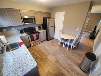 In addition to modern stainless steel appliances and granite countertops, many of our kitchen spaces are furnished with tables and chairs.