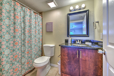 Full-sized bathroom with shower.