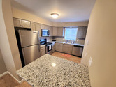 Our kitchen space is fully equipped with granite countertops.
