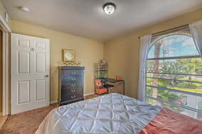 Sunlight filled off-campus housing bedroom.