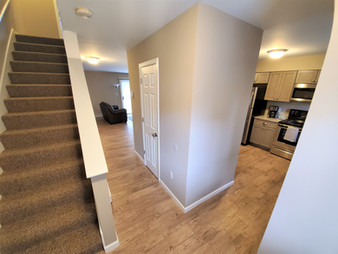 All of our downstairs living space is equipped with wood flooring.