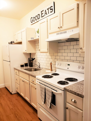 Granite Countertops and Tile Backsplashes in Every Kitchen