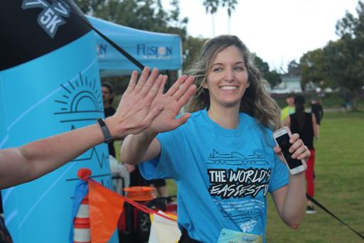 Girl Hi Five at finish line.jpg