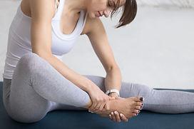woman-massaging-her-foot-during-sport-pr