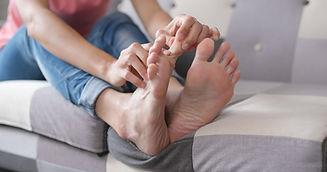 woman-feeling-pain-on-her-toe-XD2SUDJ.jp