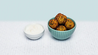 Bowl of cheese croquettes with cream