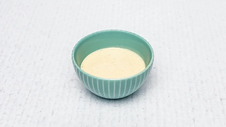 Small bowl of cheesy salat sauce