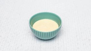 Small bowl of cheesy salat sauce