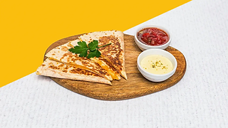 Cheesy quesadilla with salsa and cream on a wooden plate