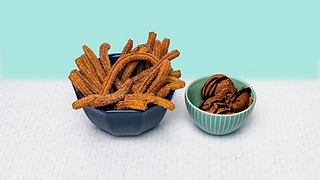 Churros in a bowl with chocolate ice cream