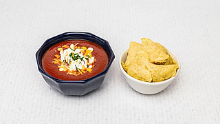 Home made tomato soup with cheese and sour cream