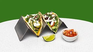 Vegetarian tacos on a steel holder