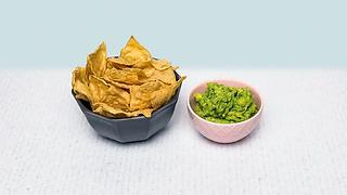 Bowl of tortilla chips and guacamole