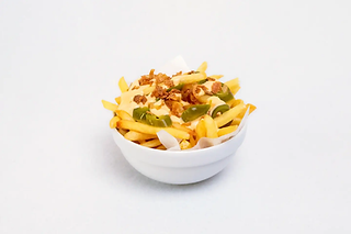 French fries in a bowl topped with cheese, fried onion and jalapenos