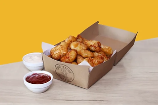 Box of home made chicken nuggets with dips