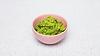 Pink bowl of fresh guacamole