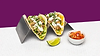 Pork tacos on a steel holder