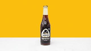 Bottle of mango flavoured soda