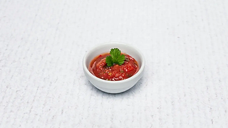 Small bowl of tomato sauce with parsley