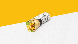 Small chicken burrito wrapped in paper