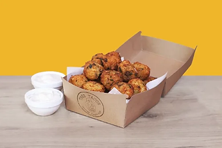 Box of home made cheesy balls with dips