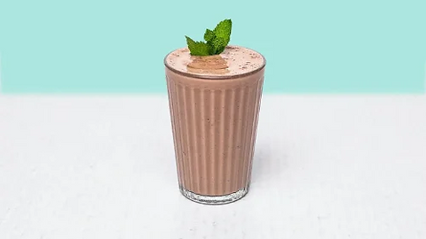 Chocolate milkshake in glass with mint on top