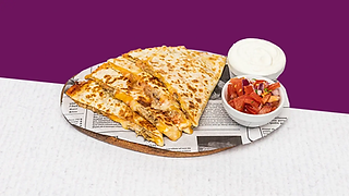 Pork quesadilla served on a wooden plate with sour cream and salsa