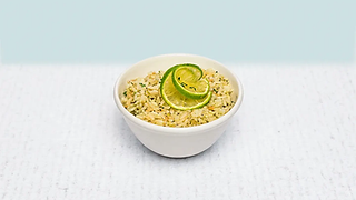 Bowl of cilantro lime rice with lime on top
