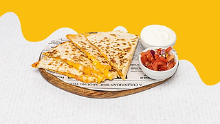 Cheesy quesadilla served on a wooden plate with sour cream and salsa