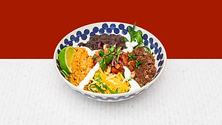 Burrito Bowl full of rise, beans, cheese, beef meat