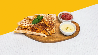 Cheesy quesadilla with grilled chicken breasts with salsa and cream on a wooden plate