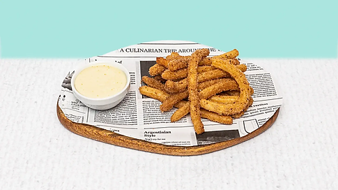 Churros served on a wooden plate
