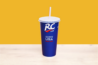 Paper cup for postmix beverage with white straw and yellow background