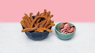 Churros in a bowl with strawberry ice cream