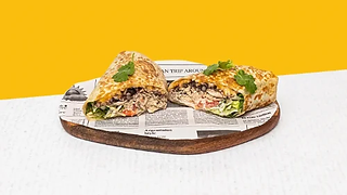 Chicken burrito served on a wooden plate