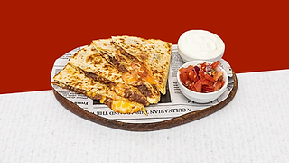 Beef quesadilla served on a wooden plate with sour cream and salsa