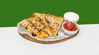 Vegetarian quesadilla served on a wooden plate with sour cream and salsa