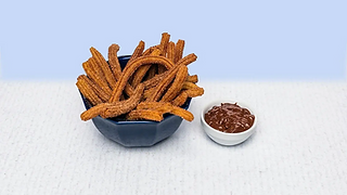 Churros in a bowl with chocolate dip